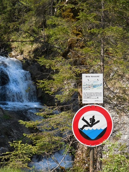 accountability: if you don't do it no one will. Watch that first step. waterfall stream creek river falls fall sign warning trees nature outside outdoors photo