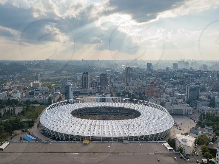 KIEV UKRAINE - July 19 2018. Aerial view from drone to a city landscape and National Olimpic Complex in Kiev Ukraine at sunset on a background cloudy sky in a summer day. photo