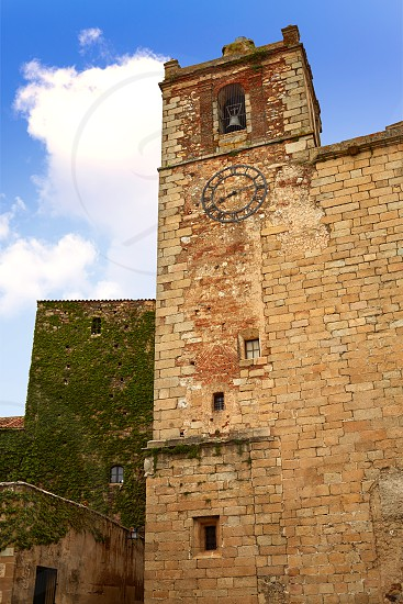 Caceres Saint Mateo church and clock in Extremadura of spain photo