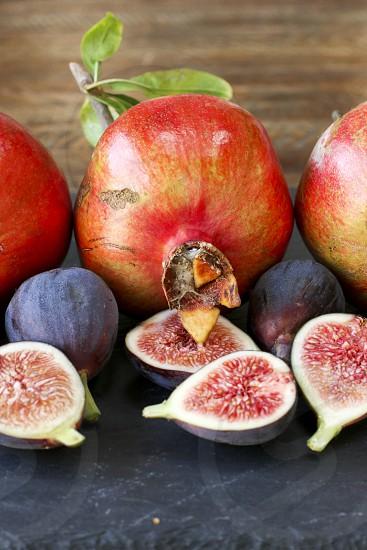 fig figs pomegranate pomegranates fruit fall fresh produce red purple pink photo