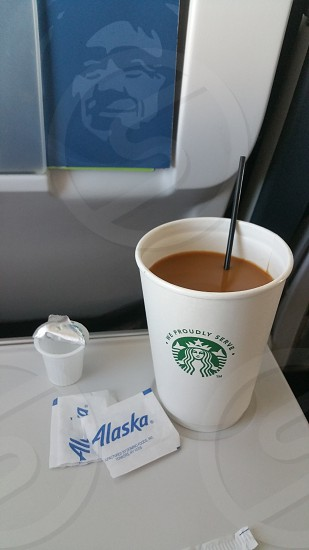 Enjoying beverage service on the flight from Sitka to Seattle. Can't pass up a cup of coffee! #alaskairlines #flying photo