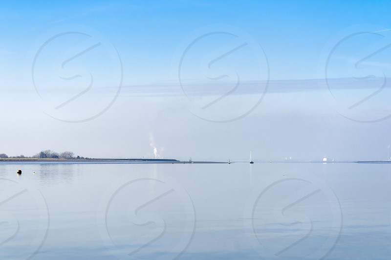 View of the River Swale from Harty Island Kent on a Tranquil Winter Day photo