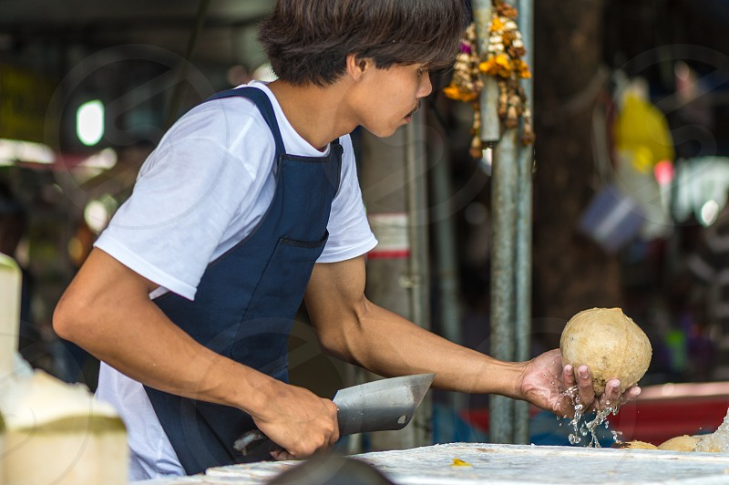 Street food - coconut water in whole coconut in Bangkok Thailand photo
