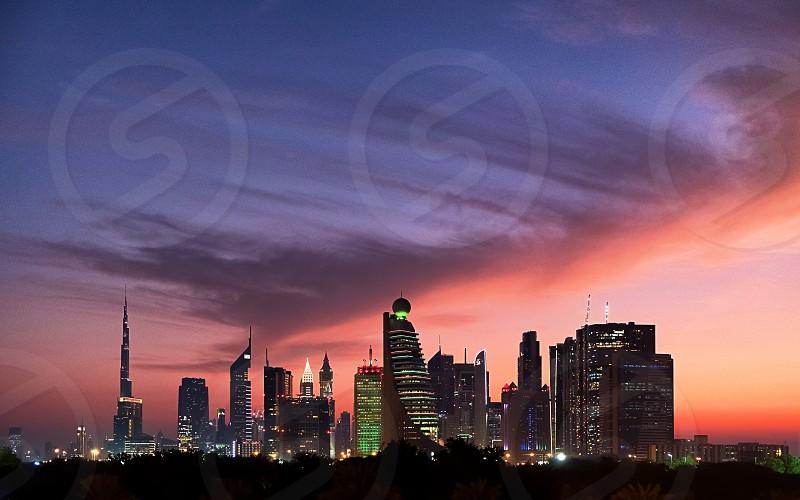 Dubai dreamy skyline as the sun goes down and the city lights up. photo
