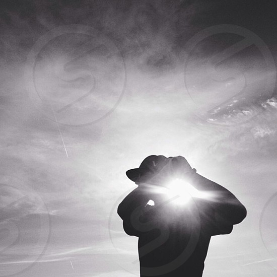 man playing golf silhouette photograph  photo