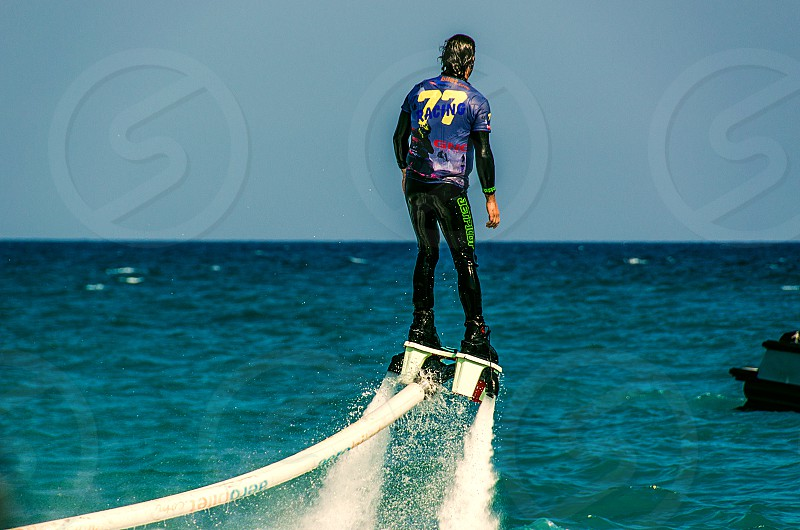 A flyboarder on the Mediterranean. photo