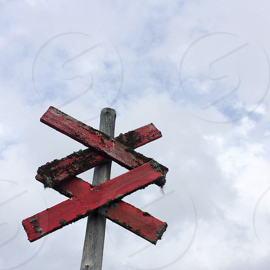 red and gray wooden sign photo