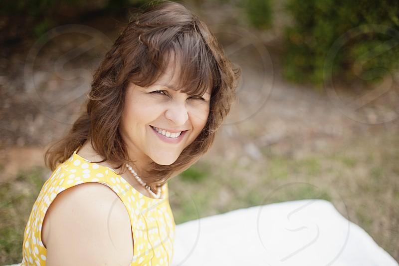women's yellow sleeveless round neck dress with white polka dots photo