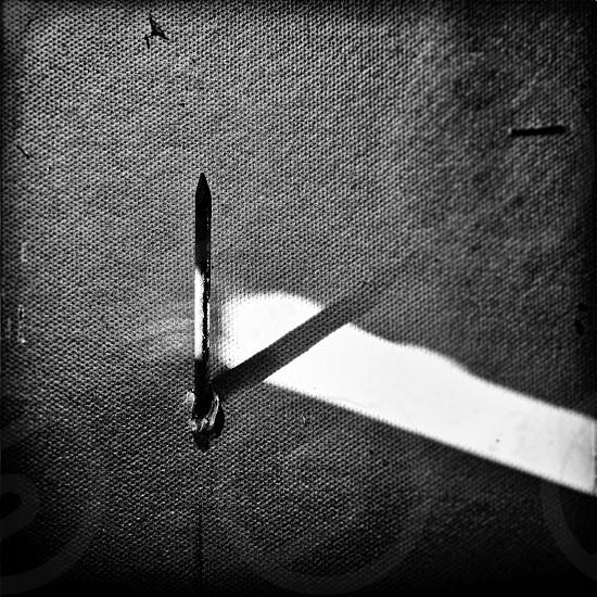 nail wall shadow object black and white noir dark moody simple minimal old grungy photo