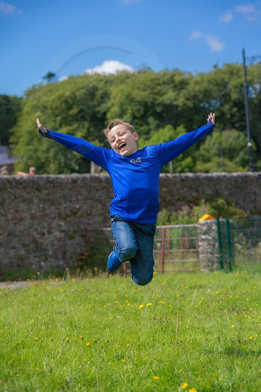 Jumping for joy at summer holiday freedom from school. photo