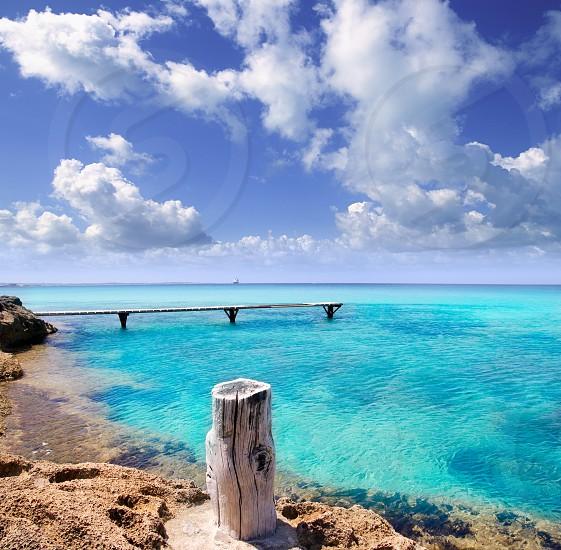Illetes illetas beach wooden pier turquoise sea Formentera Balearic islands Mediterranean photo