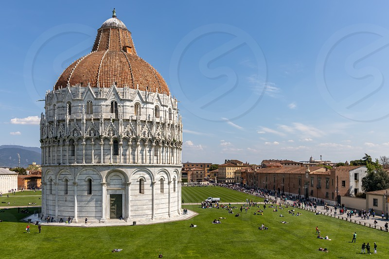 PISA TUSCANY/ITALY  - APRIL 18 : Exterior view of the Baptistery in Pisa Tuscany Italy on April 18 2019. Unidentified people photo