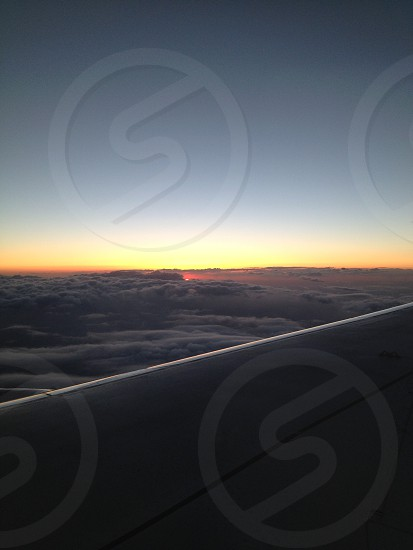 airplane wing in cloudy sky photo