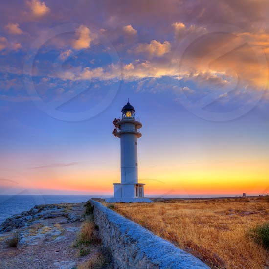 Formentera sunset in Barbaria cape lighthouse at Balearic Mediterranean islands photo