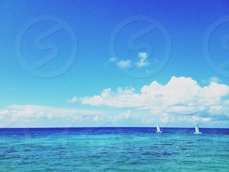 2 boats sailing on sea photography photo