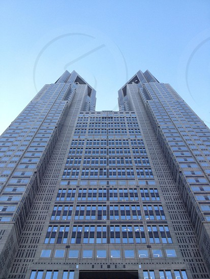 View of twin skyscraper building from ground photo