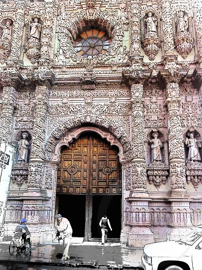 people in front of cathedral  with brown wooden door photo