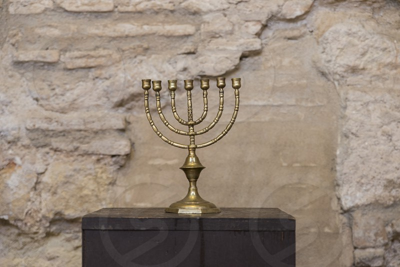 old religious menorah with ancient wall photo