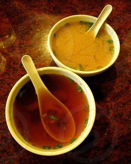 Hot and sour and egg drop Chinese soups photo