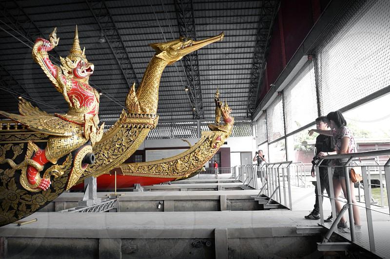 Royal barge Suphannahong and Royal Barge Narai Song Suban – Rama IX exhibited at the National Museum of Royal Barges in Bangkok Thailand photo