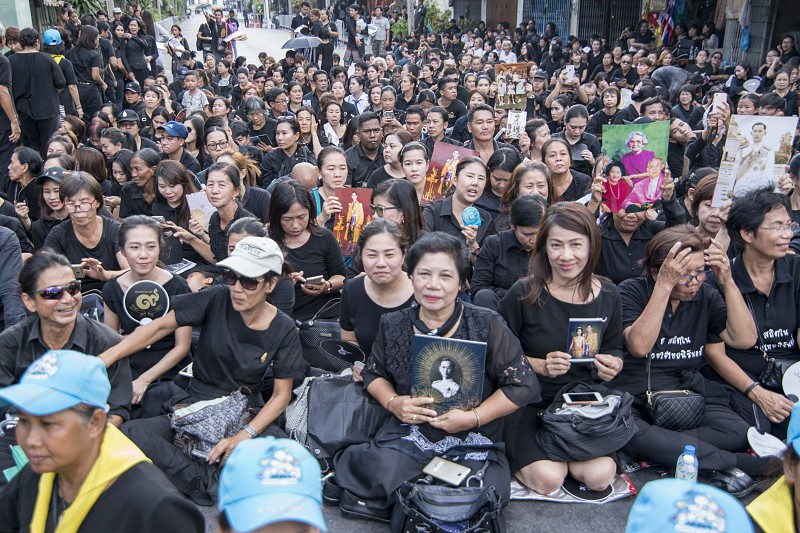 Thai People on a road at the Funeral Days of Rama 9 in the city of Bangkok in Thailand.  Thailand Bangkok November 2017 photo