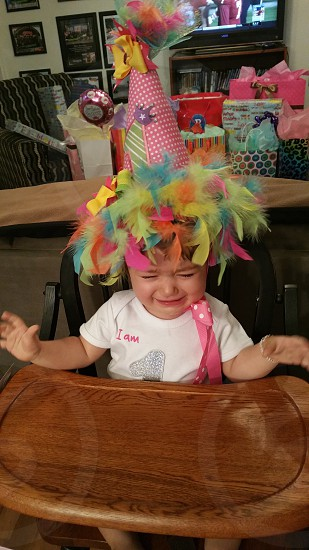 Baby doesn't like her party hat! photo