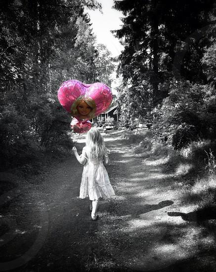 Happy walking balloon girl child daughter photo