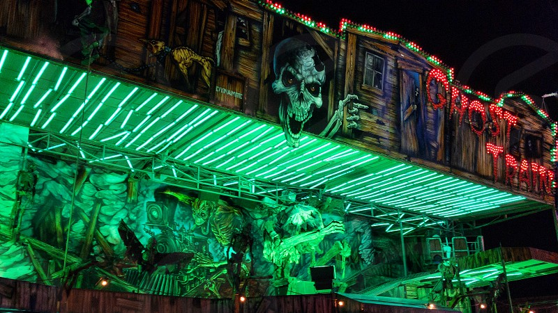 Ghost train ride at the fairground lit up at night photo