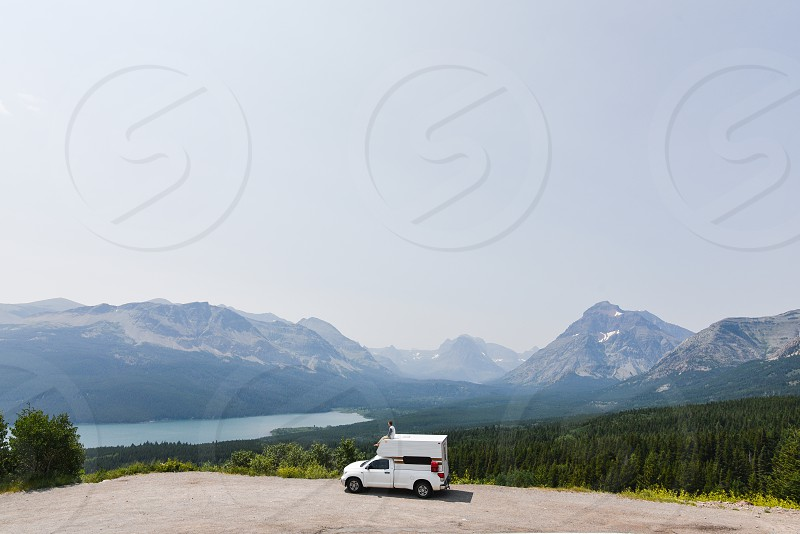 camper trailer truck pickup sky blue montana road trip glacier national park america travel drive road glamping  photo