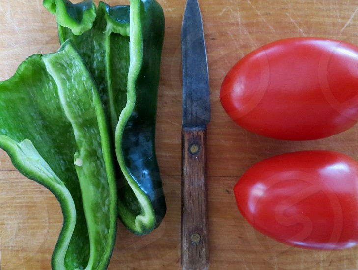 Poblano peppers plum tomatoes paring knife photo