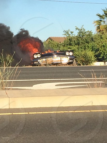 Old car on fire photo