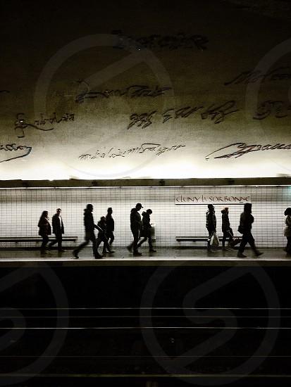 people at subway train platform photo