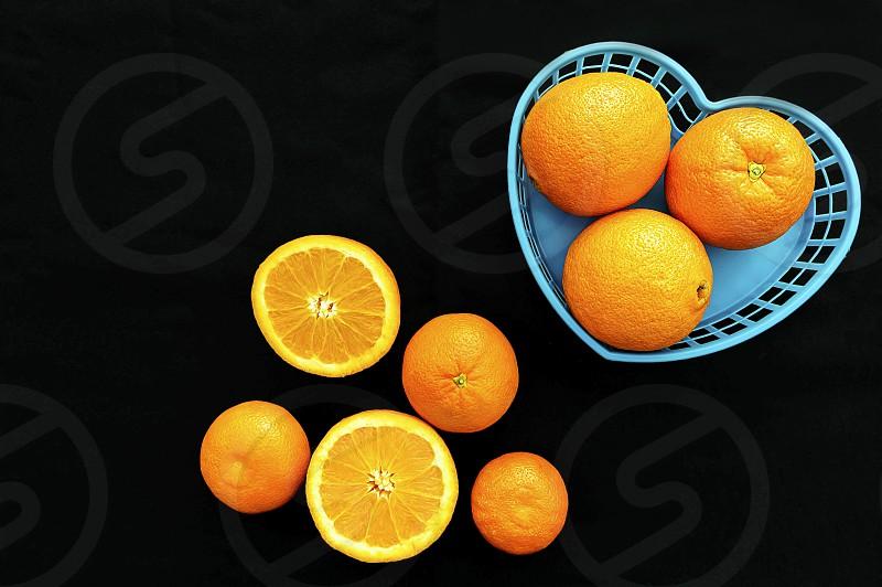 Oranges black background photo