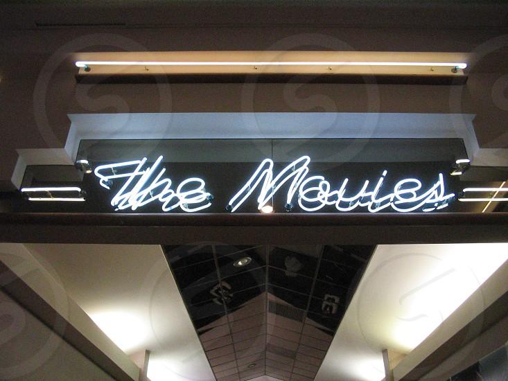 Movie theater neon sign photo