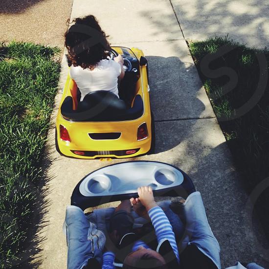 Kids going for a walk and drive around the neighborhood. photo