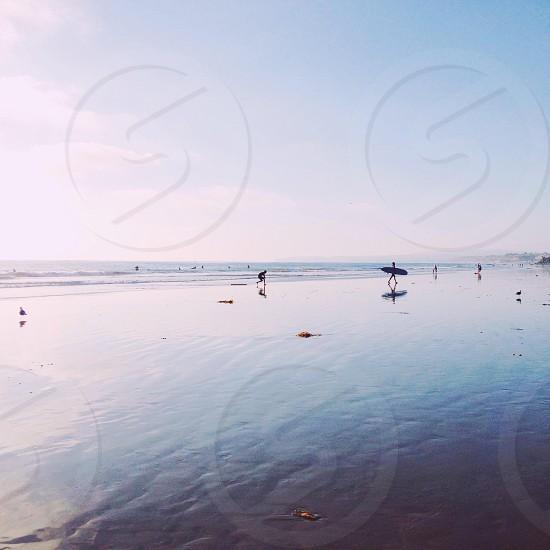 people on the seashore photo