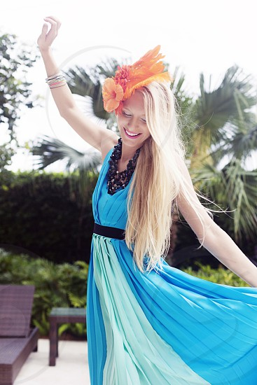 woman in blue black belted halter maxi dress photo
