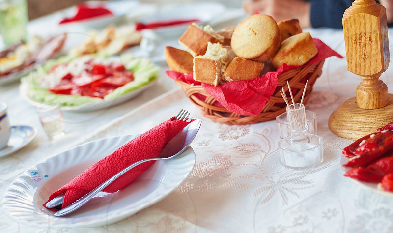 Prepared table for lunch on saint's day in Serbia traditional orthodox holidays called slava. photo