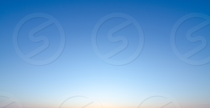 A blue sky gradient at sunrise. photo