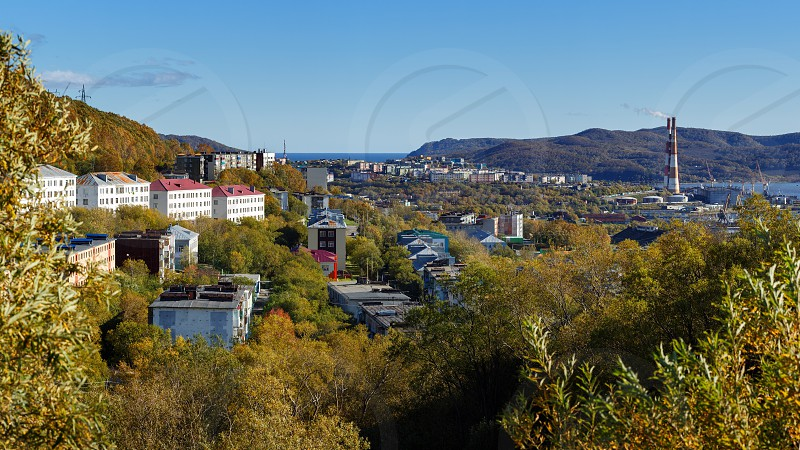 Autumn panorama view of Kamchatka city landscape old Soviet residential building of Petropavlovsk-Kamchatsky City on sunny clear day with blue sky. Eurasia Russian Far East Kamchatka Peninsula. photo
