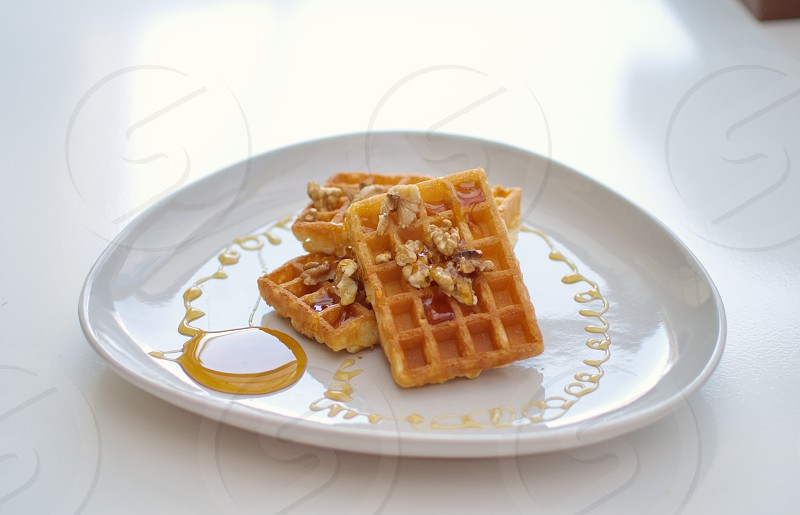 healthy Breakfast with waffles nuts and honey photo