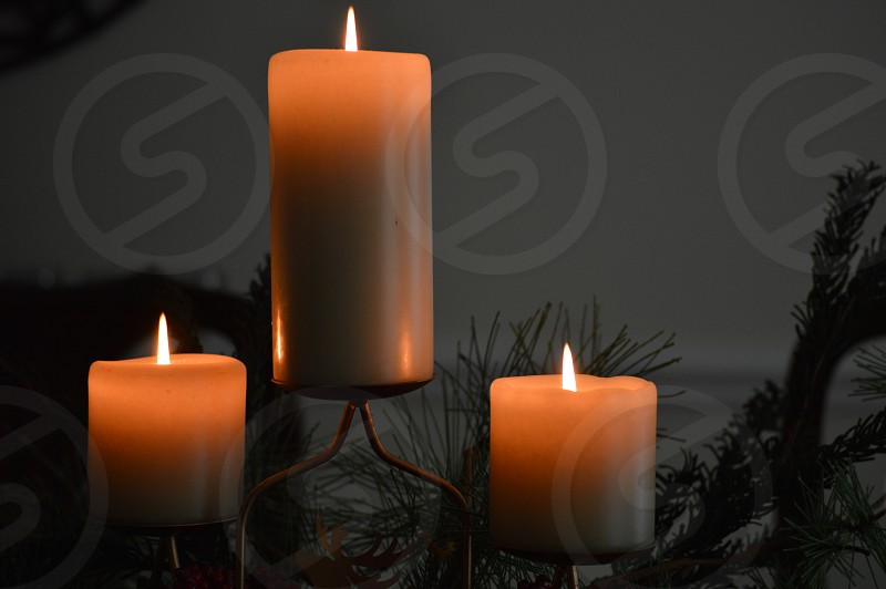 white pillar candles on candelabra photo