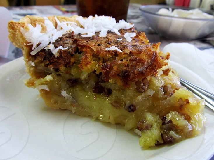Pineapple coconut pecan pie slice photo