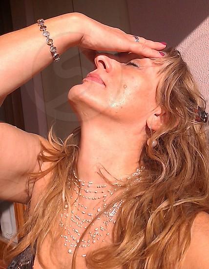 woman beige tank top with rhinestones photo