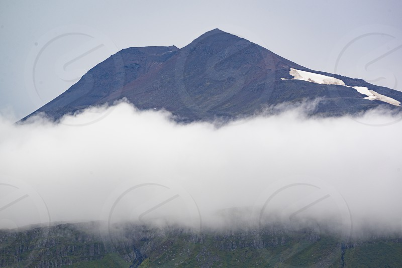 photo of mountain covered with white clouds photo