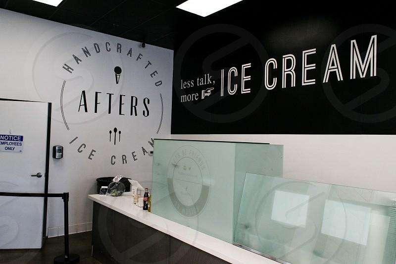 less talk more ice cream signage inside room photo