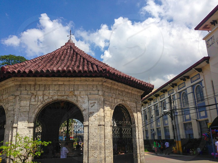 Magellan's Cross a Christian cross planted by Portuguese and Spanish explorers as ordered by Ferdinand Magellan upon arriving in Cebu in the Philippines housed in a chapel next to the Basilica Minore del Santo Niño on Magallanes Street in front of the city center of Cebu City photo