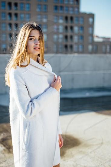 woman with white jacket photo
