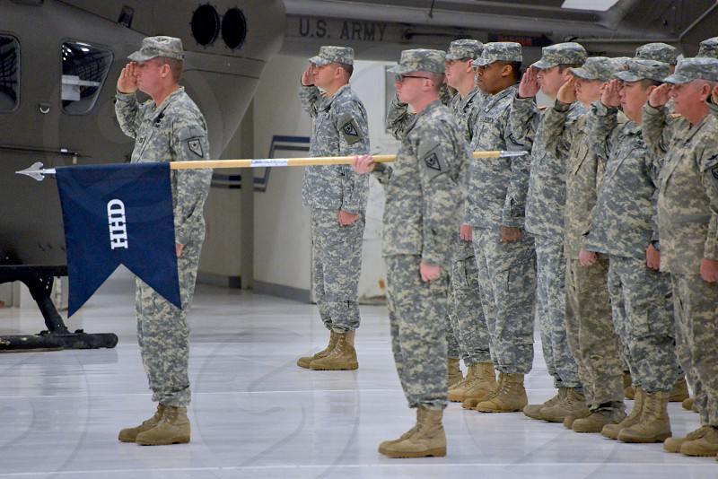 army platoon standing and doing a hand salute photo