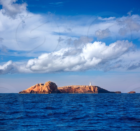 Ibiza Islas bledas Bledes islands with lighthouse from Mediterranean sea of Balearic Islands photo